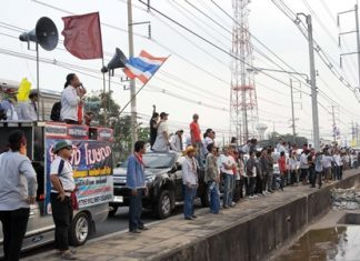 Around 2,000 striking workers at General Motors (Thailand) Co.'s Rayong factory are picketing outside the plant, saying the automaker added a Saturday shift without paying overtime. Company officials have agreed to meet, but are denying wild claims the company is losing 10 billion baht a day during the strike.