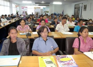 Cooks and vendors listen to a lecture about food-safety laws in Sattahip.