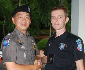 """The superintendent of Pattaya's tourist police, Lieutenant Colonel Aroon Promphan (left), has announced the appointment of Wayne Walton to be the new group leader of Pattaya's Foreign Tourist Police Assistants (FTPA). Wayne, 45, has many years' experience of UK policing including UK Royal Protection, and additional experience in the private sector organizing Close Protection for various dignitaries. Wayne said, """"I am honoured to take over leadership of FTPA in Pattaya following the resignation of Rey Dominguez who will be spending more time in the USA. I hope to involve many more people in FTPA in the future to make the team more dynamic and professional."""" He explained that the 45 member-strong FTPA had a priority to recruit more Russian-speaking members in view of the changing visitor profile on Walking Street. The role of the auxiliary FTPA is to assist the regular tourist police, principally at the mobile unit on Walking Street, dealing with general tourist questions as well as assisting with visitors' difficulties and helping to keep public order as and when necessary. They also work with Thai tourist police volunteers. In recent years, FTPA has attempted to become more professional with a lengthy induction programme and regular ongoing training and meetings. Applicants must possess a one year visa in Thailand and have police clearance from their home country. There is a strict disciplinary code and a detailed manual of correct procedures. Most FTPA have police, army or security backgrounds or have other relevant skills such as foreign language fluency or diplomatic experience. Barry Kenyon, the press officer said, """"Most people remember the famous TV series Big Trouble in Thailand, but FTPA has evolved in many ways since then. Wayne has a big task ahead in ensuring the organization is progressive and up-to-date, but he's surely the right man for the job. Pattaya is now attracting huge numbers of Russian, Indian and Chinese tourists and our structures need to tak"""