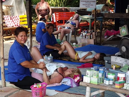 Chanhom Ngamdee quit her permanent job to join other women on Wong Amat Beach, laying mats to offer mobile massage and beauty services.