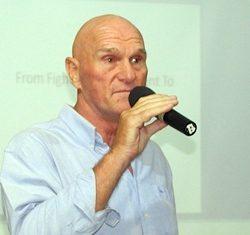 PCEC Member Chris Harman introduces long time friend Doug Campbell, a former speech and debate coach.