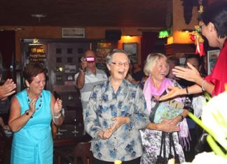 Surprise! Around 80 of Sister Joan's friends and well-wishers hid in Jameson's Irish Pub to surprise her on her 80th birthday.