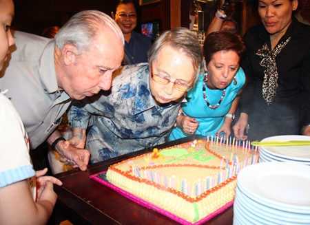 Sister Joan enlists help to blow out all 80 candles.