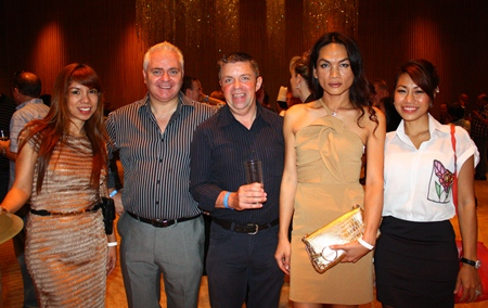 (L to R) Nitjaree Jaemsawang from Clare Pattaya Property Co., Ltd.; David Strachan, Consultant with PFS International; Paul Strachan, Yanisa Srisuk from Clare Pattaya Property Co., Ltd and Sudaporn Changthong, Director of Infinity Magazine line up for a photo op.