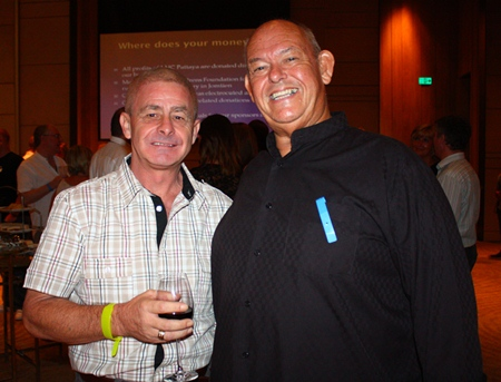 Lyndsey Rowe (left), Senior Client Advisor of MBMG Group enjoys a humorous moment with Rodney James Charman.