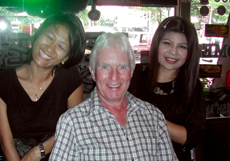 Geoff Stubbs (center) poses with staff at the Beaver Bar & Grill.