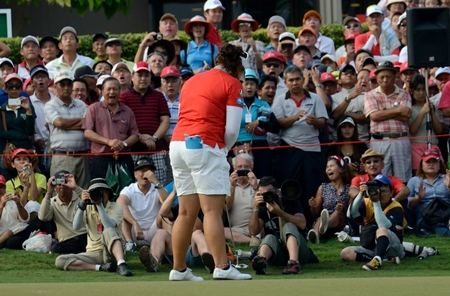 The gallery around the 18th green gasps as Jutanugarn misses a short putt to force a playoff.