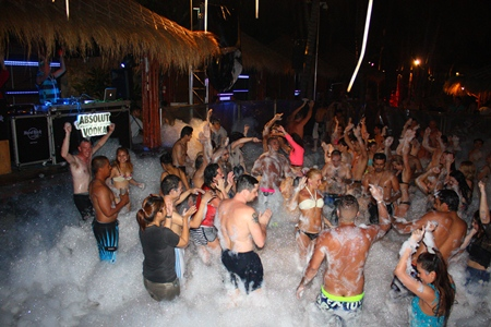 Night party-goers rocking hard at the Hard Rock foam party.