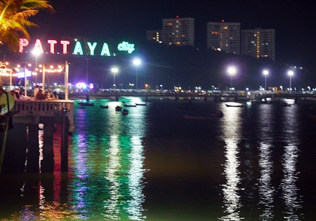 Seated on the deck over the water, cooled by the sea breezes, you can look across Pattaya Bay towards Bali Hai.