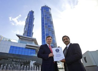 Rupprecht Queitsch, General Manager of the JW Marriott Marquis Hotel Dubai is joined by Ashok Korgaonkar, leading architect of the building and Managing Director of Archgroup Consultants, as they receive the official Guinness World Record certificate for the world's tallest hotel.