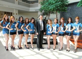 Christoph Voegeli, GM of the Royal Cliff Hotels Group is surrounded by a bevy of beautiful ladies during the FHM Magazine's Girls Next Door Competition photo shoot at the Royal Cliff Hotels Group recently.