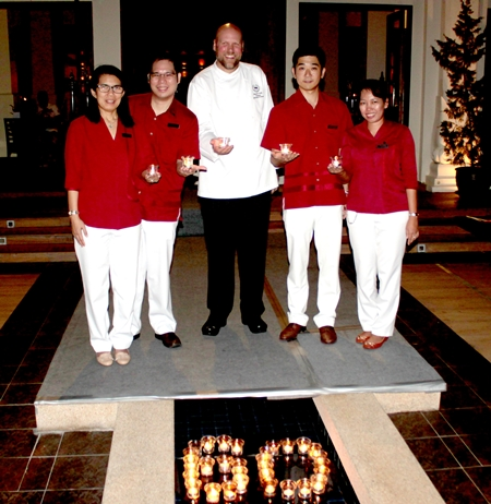 """The Sheraton Pattaya Resort participated in Earth Hour 2013 recently. Tomo Kuriyama (2nd right), GM of the hotel said, """"It's a privilege for us to support such a powerful movement with such a simple gesture. Earth Hour also reflects a philosophy we try to practice year-round: The small steps each of us takes can make a big difference together."""""""