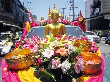 Lord Buddha looks completely at peace during the flower parade.