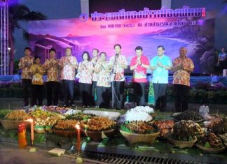 Mayor Itthiphol Kunplome leads city officials in saying prayers at the beginning of the ceremonies.