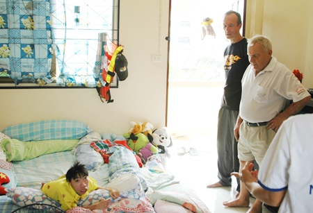 Woody and Bernie visit Nong Ice, who is suffering from scoliosis, or curvature of the spine, and cannot stand.