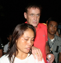Ralph Wies and his wife Phayao are arrested for allegedly operating the German International School without a license.
