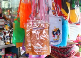 Plastic pouches for keeping valuables dry during Songkran hang for sale among the water guns and other paraphernalia.