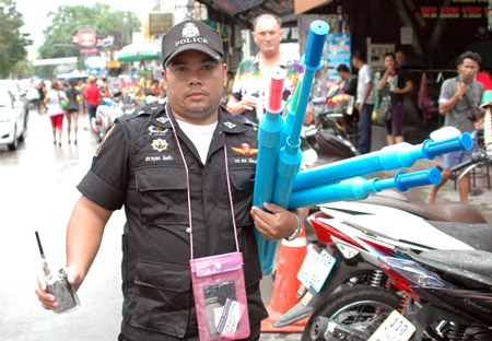 Police had the unpopular task of rounding up PVC water cannons early in the Songkran week, as can be seen by the sour faces in the background.