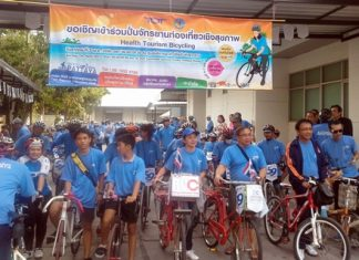 """Cyclist prepare to head out on an 11 km """"Cycling for Health"""" bike-a-thon."""