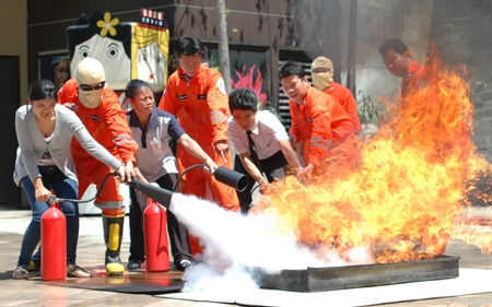 Employees at the mall are taught how to use fire extinguishers during Central Festival Pattaya Beach's quarterly fire drill.