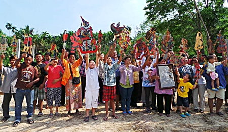Cast and crew hold up shadow puppets during announcement for the upcoming Nang Talung Shadow Play Preservation Center.