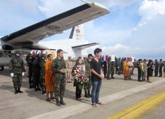 Family and comrades gather on the tarmac at Sattahip Naval Base to bring home the bodies of three marines killed by a booby-trapped bomb in Thailand's restive south.