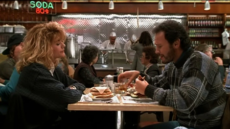 """Meg Ryan and Billy Crystal, stars of the 1989 movie """"When Harry Met Sally."""" This is the famous fake orgasm scene in a New York deli, which culminates with another restaurant patron pointing to Meg and ordering """"I'll have what she's having."""""""