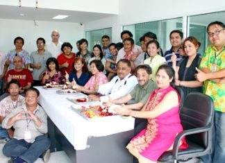 "Marlowe and Peter Malhotra (seated, 2nd & 3rd right) lead the Pattaya Mail ""family"" in traditional Songkran blessings."