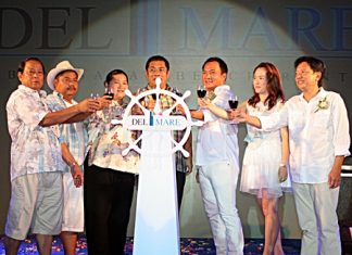 Management executives and honored guests give a grand opening toast for the new Del Mare Bang Saray development.