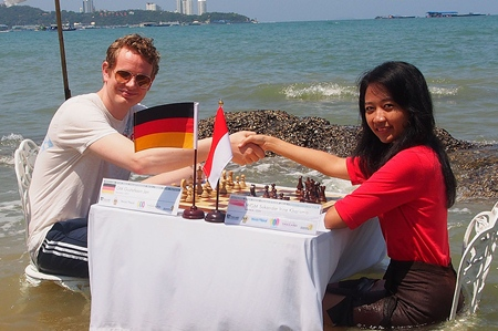 Germany's Jan Gustafsson (left) cools off in the sea with Grandmaster Irine Sukandar of Indonesia.