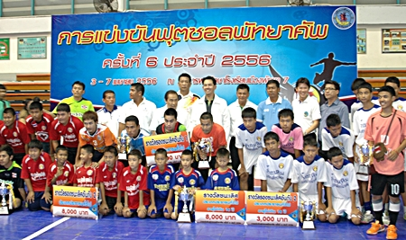 Winning teams show off their trophies as they pose with dignitaries and officials at the conclusion of the tournament.