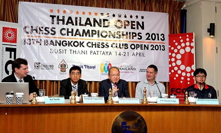 Chatchawal Supachayanont (center), general manager of Dusit Thani Pattaya, gestures as he welcomes the chess players, officials and sponsors of the Thailand Open Chess Championships during the press conference in Bangkok to launch the 13th Bangkok Chess Club Open.
