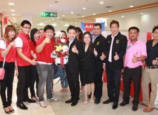 Management, staff and local officials gather for the grand opening of Air Asia's customer service center at the Tesco-Lotus mall in South Pattaya.
