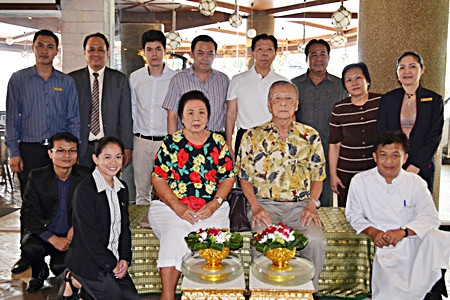 Somchai Ratanaopath (rear 4th left), Chairman of the Board, and Somkiet Ratanaopath (rear 4th right) standing), Managing Director of the A-One The Royal Cruise Hotel Pattaya gathered together his management and staff to pay their respects to Mitr Ratanaopath and Wantana Ratanaopath (seated) founders and owners of the hotel.