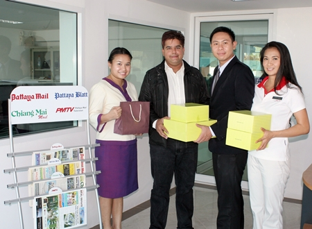 Assistant Spa Manager Nuradee Ruangchaipramote (left), Public Relations Executive Arwuth Tiampakdee (2nd right), and Fitness Manager Panthip Pongkio (right), of Dusit Thani Pattaya congratulate Suwanthep 'Tony' Malhotra (2nd left), deputy managing director of the Pattaya Mail Media Group on our move to the new offices combined with best wishes for the Thai new year.