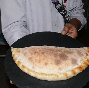 Surapat suggested we try his calzone, which was served on a black slate plate and had ricotta, prosciutto ham, pecorino cheese and spinach as the filling.
