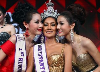 Miss Tiffany's Universe 2013 Netnapada 'Neck' Kalyanon (center) receives a congratulatory peck on the cheek from first runner up Chananchida 'Blossom' Rungpetcharat (left) and second runner up Sopida 'Ning' Rachanon (right) at the globally televised Miss Tiffany Universe 2013 contest held at Pattaya's Tiffany Theater May 3.