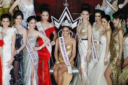 Contestants crowd around the newly crowned Miss Tiffany Universe 2013.