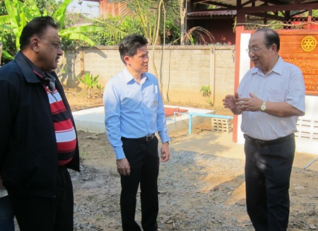 PDG Preecha Jadsri (right) updates PDG Peter and DG Aurak on the progress of the water project.
