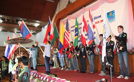 Youth Exchange students carry international flags at the opening ceremony.