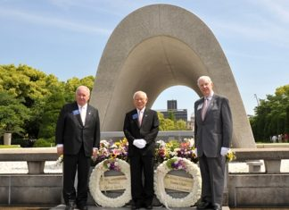 Past RI President Luis Giay (left), RI President Sakuji Tanaka (centre), and Rotary Foundation Trustee Chair Wilfrid J. Wilkinson (right) lay wreaths at the Memorial Cenotaph in the Hiroshima Peace Memorial Park during the Rotary Global Peace Forum 17 May. (Photo courtesy of Noriko Futagami, The Rotary-no-Tomo)