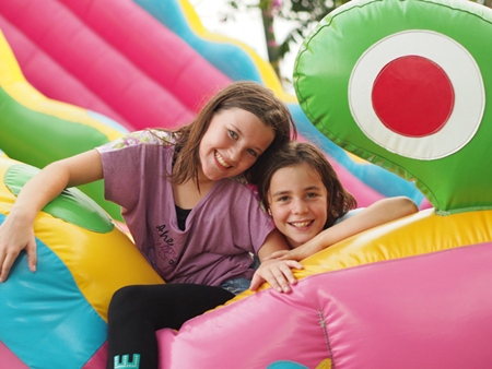 Children enjoy the bouncy castle.