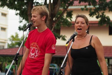 Staff perform a vocal duet.