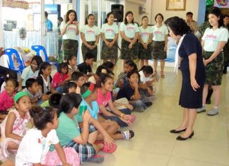 The Navy Wives Association helps teach youngsters to speak English.