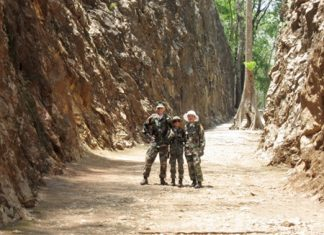 Young Marines in Hellfire Pass. (L to R) Unit Commander Rad, PFC Bret and Adult Leader Nok Mays. (Photo by Adult Leader Joey Fink)
