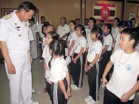 Rear Adm. Noppadol Suphakorn visits with the students attending the camp.