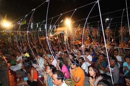 Folks attend the casting of Lord Buddha's statue, the head being cast in gold, at Wat Chaiyamongkol.