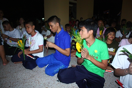 Children from the Redemptorist School for the Blind chant their flowers presentation words before the Wien Thien ceremony.