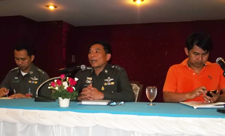 Col. Chatchawan Pisuthwong (center) lays out policies on morality and service for his officers.