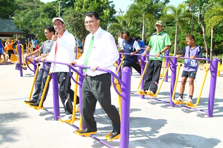 Mitsubishi Electric Kanyong Wattana Co. Managing Director Anant Banjerdthum, along with Mayor Itthiphol Kunplome, local officials and guests try out the new exercise equipment.